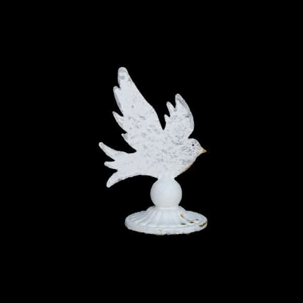 Small metal dove mounted on decorative stand