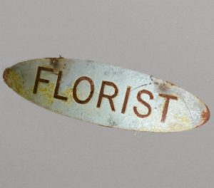Florist sign on oval backplate