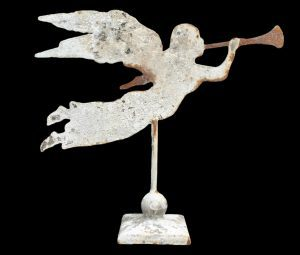 Winged angel with trumpet on square base