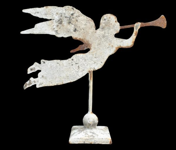 Winged angel with trumpet on stand