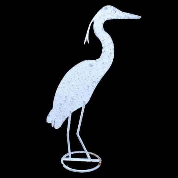 Life size metal profile of a painted and distressed heron on stand