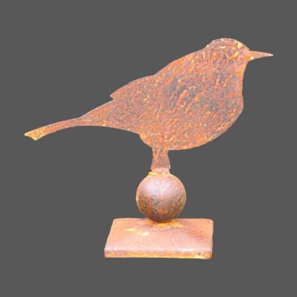 Rustic metal blackbird on stand