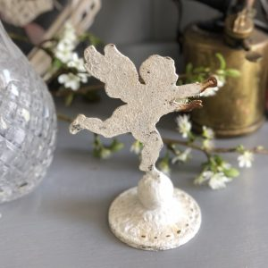 Mini cherub on decorative stand