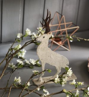Mini stag with rusty horns